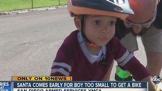 Santa comes early for boy too small to get a bike - Video