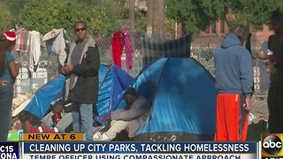 Police cracking down, lending help to homeless community - Video