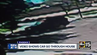 Surveillance video captures moment car crashes through home in Phoenix - Video