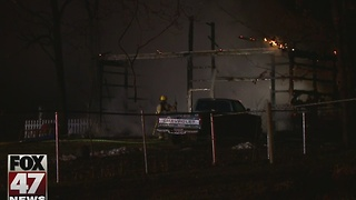 Heat lamp sparks Delta Township pole barn fire - Video