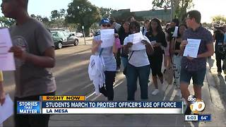 Students march to protest officer's use of force