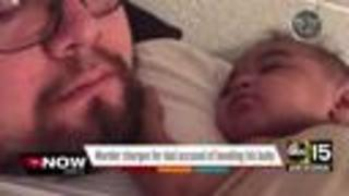 Phoenix father accused of bending his baby facing murder charges - Video