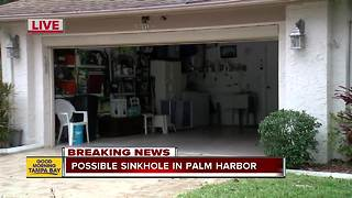 Woman evacuates sinking Palm Harbor home - Video