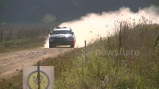 Rally spectator runs for his life as car crashes into barrier - Video