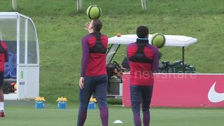 Jesse Lingard and Phil Jones show off circus skills during England training - Video