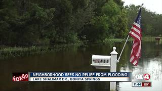 Bonita Springs neighborhood still plagued by flooding - Video