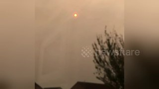 Bizarre 'red burning sun' glowing over Cardiff - Video