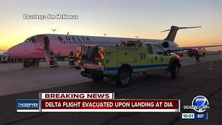 Delta flight from Detroit evacuated upon landing in Denver after smoke reported on plane - Video