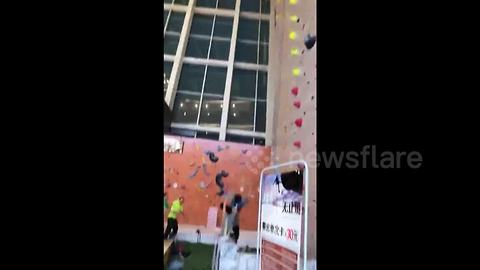 Worker falls off climbing wall in southern China