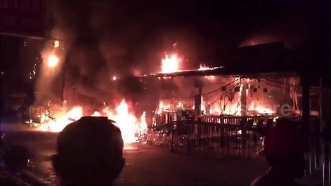 Firefighters battle flames at bars in Thai holiday resort