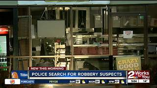 Tulsa Police search for two robbery suspects - Video