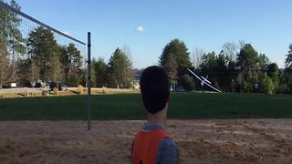 Father And Son Having Fun Flying A Remote-Control Airplane