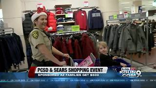 Local officers take families Christmas shopping - Video