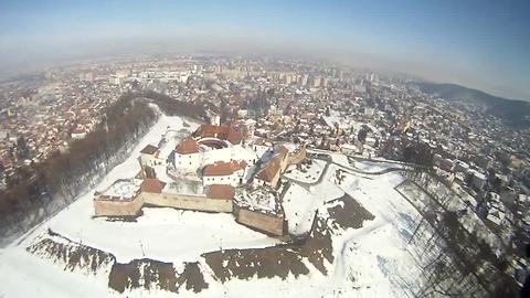 Take a POV paragliding flight over historic European site