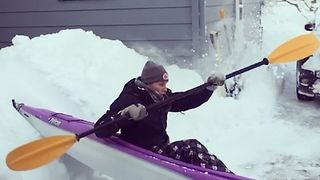 Woman Tries Kayaking Down Snowy Slope in Erie - Video