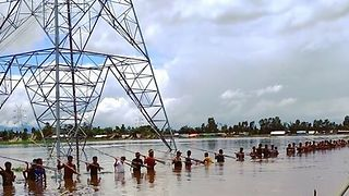 Locals Prepare to Spearfish in Manipur Floodwaters - Video
