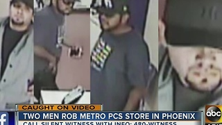 Men caught on surveillance robbing Metro PCS store - Video