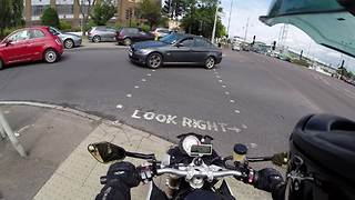Biker Spontaneously Helps Man In Deed At Busy Intersection  - Video