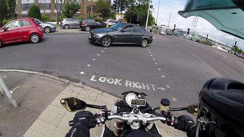 Biker Spontaneously Helps Man In Deed At Busy Intersection