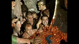 The World's Largest Tomato Fight - Video