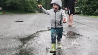 Awesome slow motion toddler puddle jumping