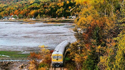 This Quebec Train Takes You On A Riverside Ride Though A Cliff & Past Stunning Fall Views