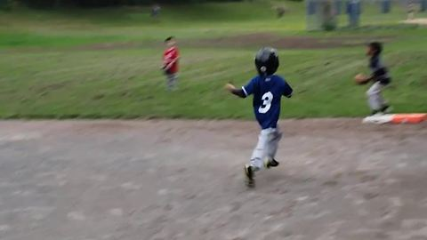 Kid hits simple grounder, results in epic home run