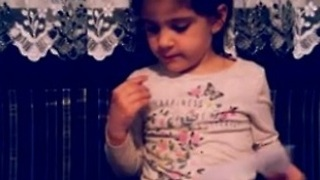 Little girl has a very unique way of reading books - Video