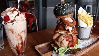 Competitive Eater Devours Monster Burger in Less Than 6 Minutes - Video