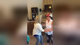 Daughter surprises parents with baby announcement - Video