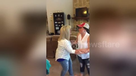 Daughter surprises parents with baby announcement