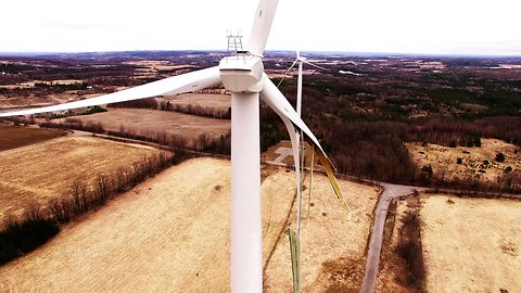 Aftermath of giant wind turbine explosion filmed by drone close up