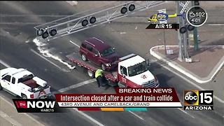 Car crashes into train in Phoenix - Video