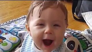 Baby's priceless reaction to scalp massager