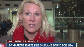 E-cigarette starts fire on plane - Video
