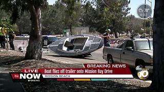 Boat flies off trailer onto Mission Bay Drive - Video