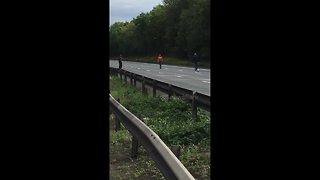 Bored commuters play motorway football - Video
