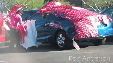 """Gift wrapping cars"" prank has emotional twist"