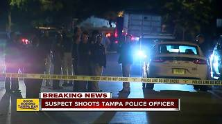 Tampa Police officer shot multiple times while serving warrant, suspect in custody - Video
