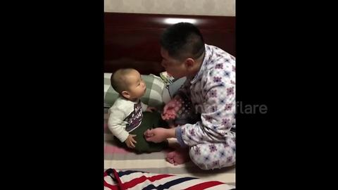 Dad spits gum on baby boy's face when trying to blow a bubble