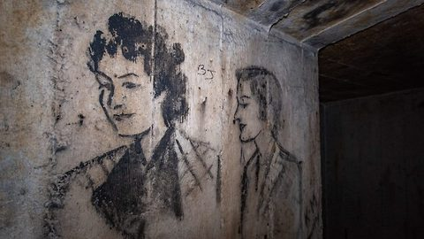 Watch: Explorer discovers WWII portraits sketched on walls of secret bomb shelter