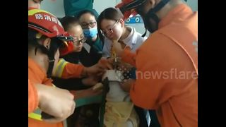 Toddler rescued after getting head stuck in pipe - Video