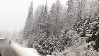 Cyclist Rides Along Snowy British Columbia Road - Video