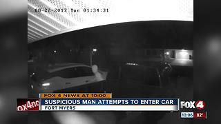 Suspicious man attempts to enter car - Video