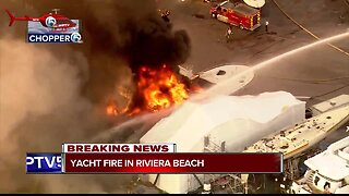 Crews battle flames after yacht engulfed by fire in Riviera Beach