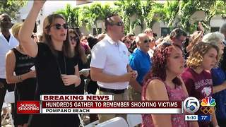 Hundreds gather to remember shooting victims - Video