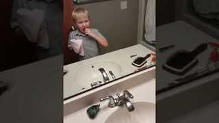 Brave Kid Removes His Own Tooth - Video