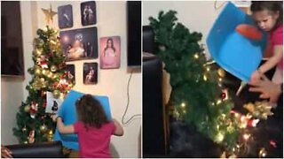 Girl knocks down Christmas tree trying to reach star