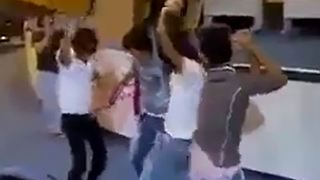Iranian students dancing in classroom