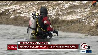 Car crashes into retention pond on city's SE side; woman pulled from water - Video